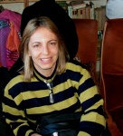 Miriam (Brazil) smiling.