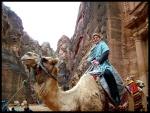 Lára on a camel in Petra